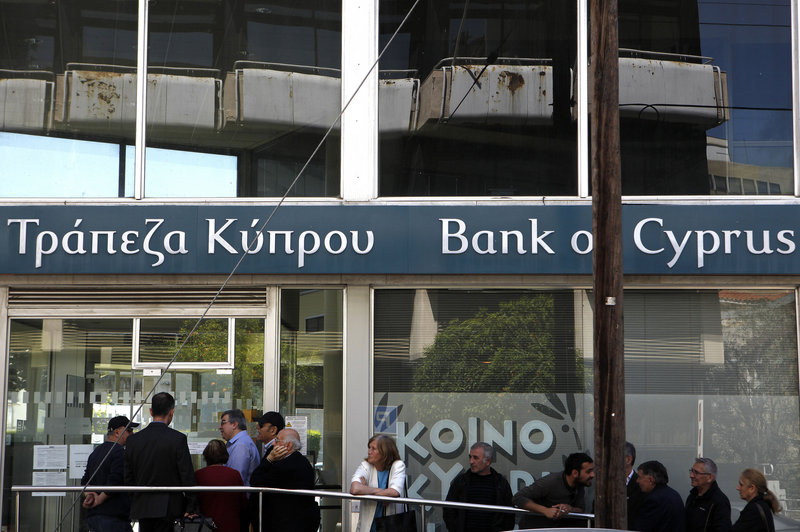 Customers wait Thursday outside a branch of the Bank of Cyprus in Nicosia as Cypriots got their first chance to access their savings in two weeks.