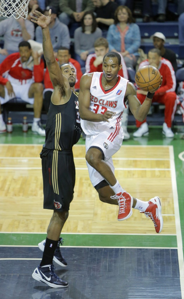 Portland's Chris Wright looks to pass against Erie's Keith Benson during Thursday's victory at a sold-out Expo, won by the Red Claws, 109-102.