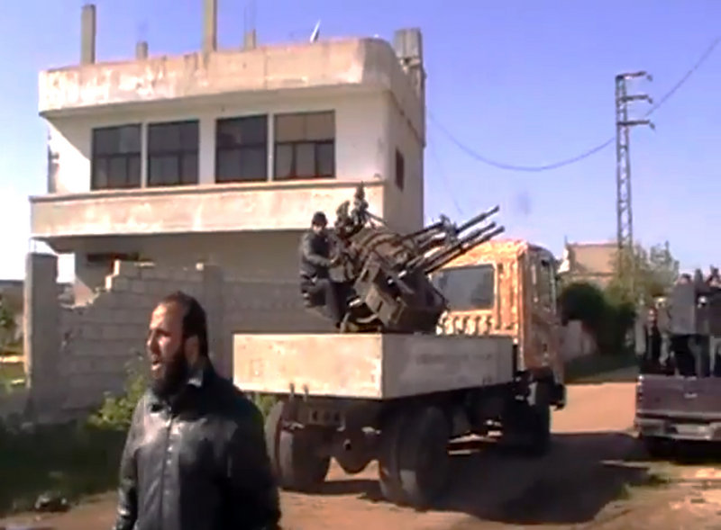 Image taken from video shows Syrian Free Army fighters in Dael, less than 10 miles from the Jordanian border.