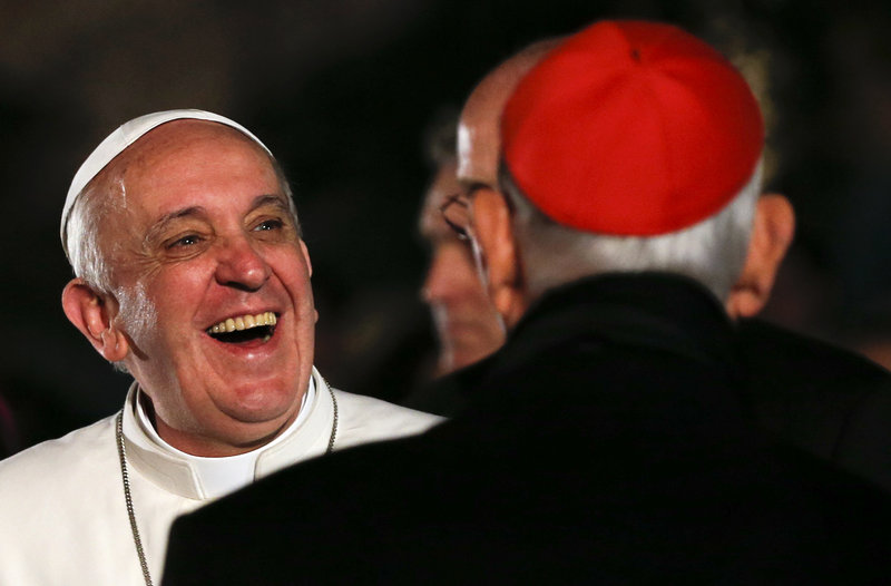 Pope Francis laughs as he arrives to lead the Via Crucis – or Way of the Cross – procession during Good Friday at the Colosseum in Rome. Francis chose to stress Christians' positive relations with Muslims in brief remarks at the end of the ceremony.