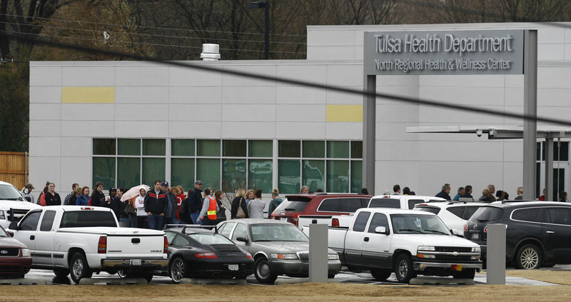 About 150 to 200 patients of Dr. W. Scott Harrington line up outside a Tulsa Health Department clinic on Saturday to be screened for hepatitis and the virus that causes AIDS.