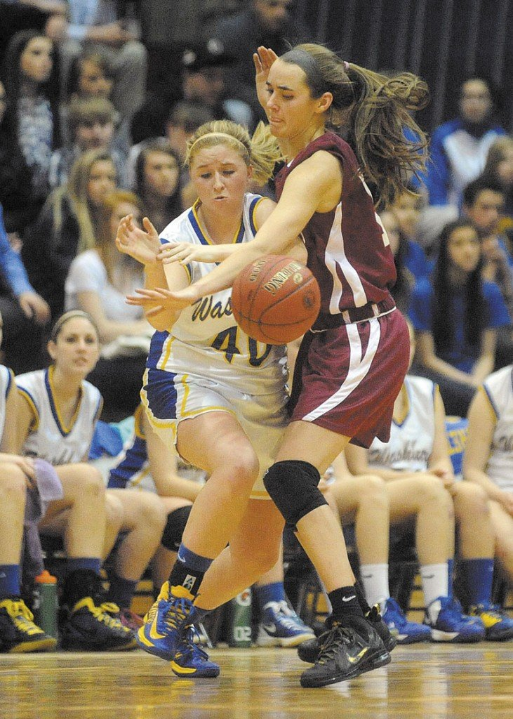 Richmond's Jamie Plummer, 15, defends Washburn's Nicole Olson, 40, in the fourth quarter of the Class D state championship game at the Bangor Auditorium Saturday. Washburn defeated Richmond 75-55 for the state title.