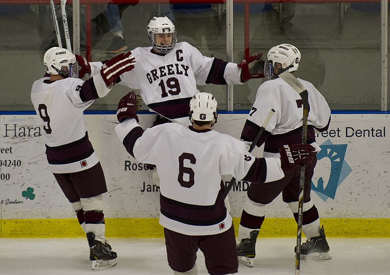 Ted Hart, 19, welcomes his teammates Wednesday night after scoring the first goal of the game – and the first of his three – to help Greely down Camden Hills 7-1 in the Western Class B championship game at Lewiston.