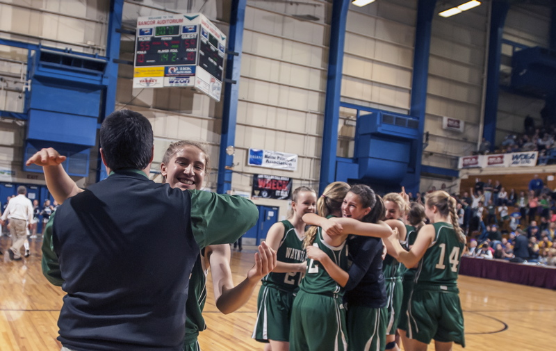 Martha Veroneau, who scored 34 points, including the final 16 for Waynflete, embraces Coach Brandon Salway after the Flyers rallied past Calais to win the Class C state title.