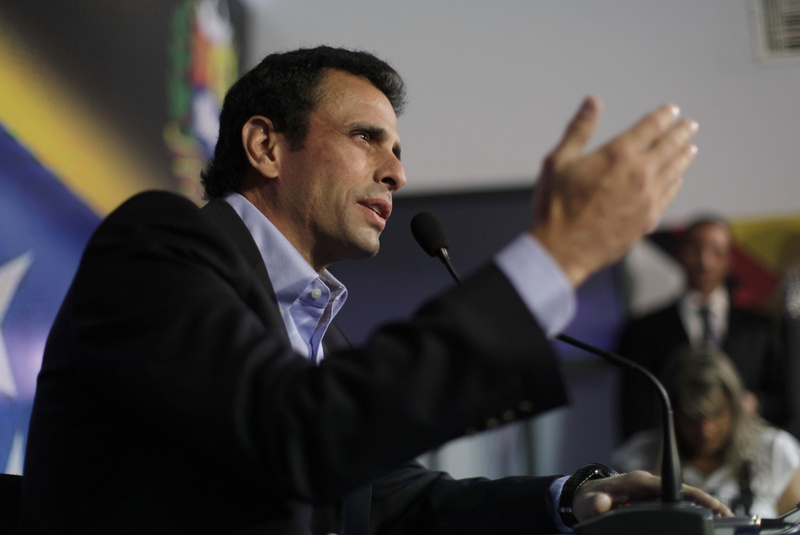 Opposition leader Henrique Capriles speaks during a press conference in Caracas, Venezuela, on Friday. Capriles, a long-shot candidate to succeed the late President Hugo Chavez, called Vice President Nicolas Maduro a bold-faced liar and accuses him of using Chavez's funeral to campaign for the presidency.