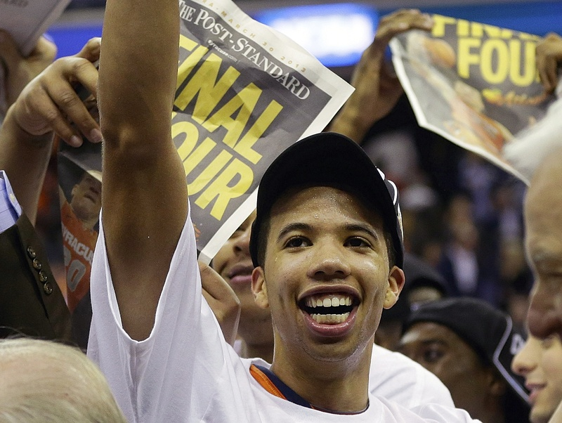 Michael Carter-Williams leads the celebration Saturday after Syracuse defeated Marquette 55-39 and advanced to the Final Four for the first time since 2003, when it won the national title.