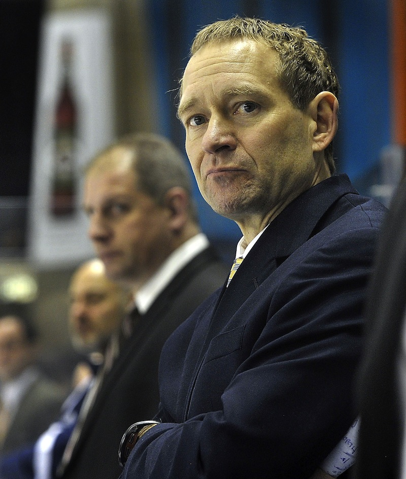 University of Maine head hockey coach Tim Whitehead looks on during a Black Bears game in January. Whitehead was fired Tuesday after 12 years at the program's helm.