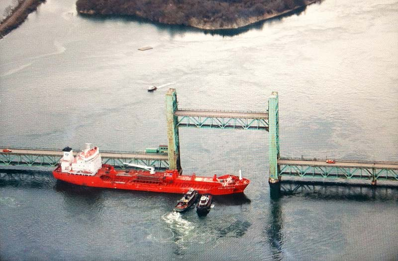 An aerial photo shows the tanker Harbor Feature sitting sideways in the Piscataqua River after hitting the Sarah Long Bridge between Kittery and Portsmouth, N.H., on Monday.