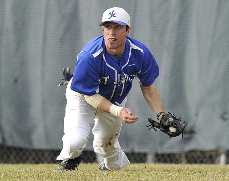 St. Joseph's centerfielder Louie Vigars comes up with the ball during a game in April.