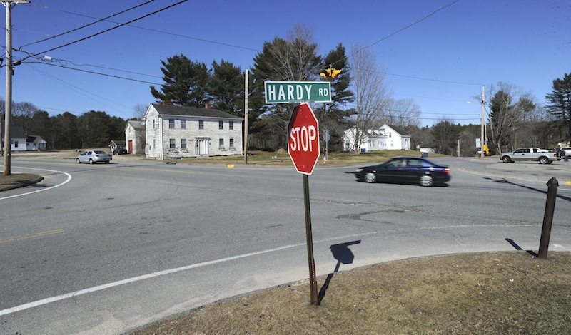 This April 9, 2013 photo shows cars traveling west on Route 302 in Westbrook where a proposed rotary for the Intersection of Route 302, Duck Pond Road and Hardy Road is being considered.