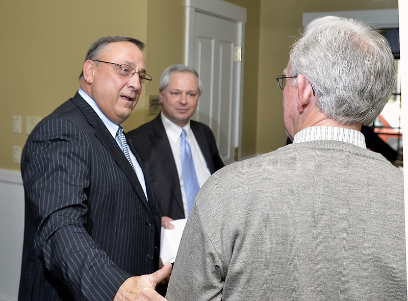 Gov. Paul LePage speaks with Charles Wallace, president of Resource Systems Engineering, at a Brunswick chamber event Wednesday. Economic adviser John Butera is in the middle.