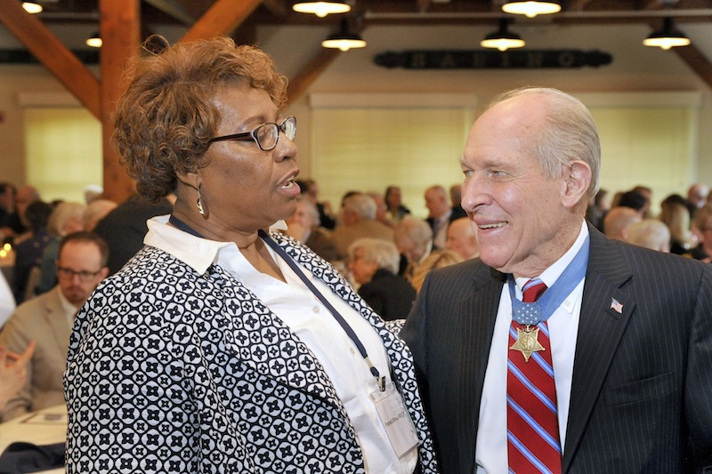 Retired Navy Capt. Thomas J. Hudner, who tried to save Ensign Jesse Brown during the Korean War, talks with Brown's daughter, Pamela Brown Knight, at a luncheon celebration Friday at the Maine Maritime Museum. Hudner is the namesake of the USS Thomas Hudner.