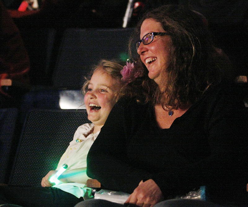 Lucy Green of Portland and her daughter Caroline, 6, enjoy the circus.