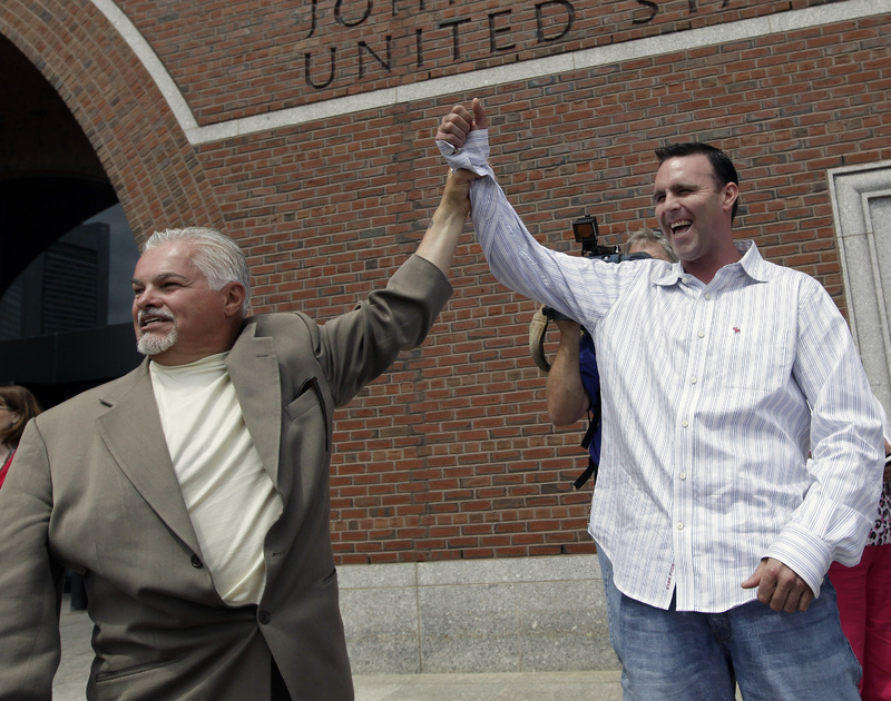"Steve Davis, left, and Tommy Donahue clasp hands as they react outside federal court in Boston on June 12, 2012, after Catherine Greig, who spent 16 years on the run with former Boston mobster James ""Whitey"" Bulger, was sentenced to eight years in prison for helping to hide one of the FBI's Ten Most Wanted Fugitives. Davis and Donahue are family members of victims."