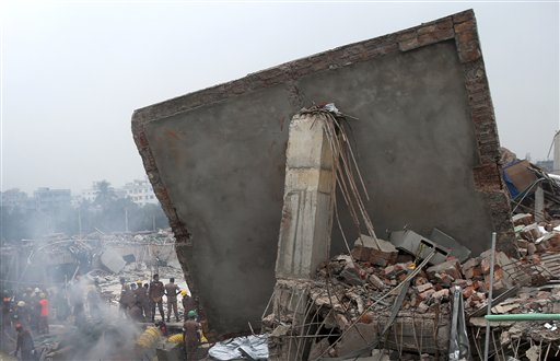 Rescue and recovery personnel prepare to dislodge the ceiling of the garment factory building that collapsed on Wednesday in Savar, Bangladesh,