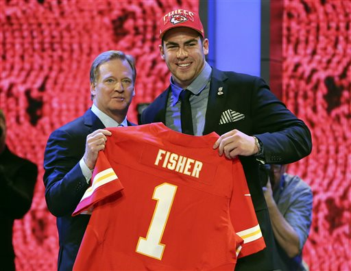 Tackle Eric Fisher from Central Michigan stands with NFL Commissioner Roger Goodell after being selected first overall by the Kansas City Chiefs in the first round of the NFL football draft Thursday at Radio City Music Hall in New York.