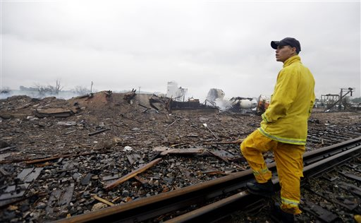A firefighter surveys the remains of a fertilizer plant destroyed by the massive explosion at the West Fertilizer Co.