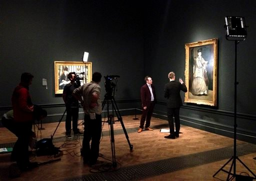 A film crew works on a film about an exhibit devoted to the portraiture of Edouard Manet at the Royal Academy of Arts in London.