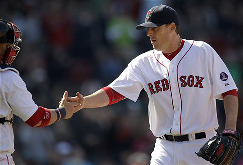 Red Sox pitcher John Lackey, right, is congratulated by catcher Jarrod Saltalamacchia after the last out in the sixth inning against the Houston Astros at Fenway Park in Boston on Sunday. The Red Sox won, 6-1. Fenway Park