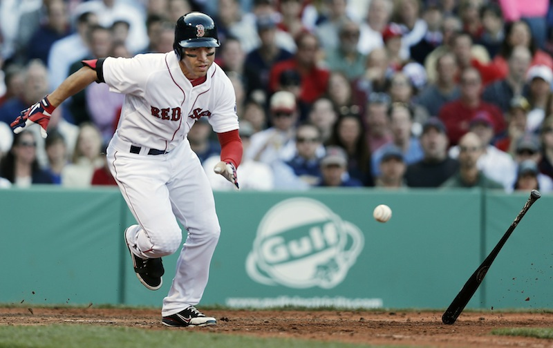 Boston's Jacoby Ellsbury runs out a hit near the plate that was ruled foul during the fifth inning Wednesday.