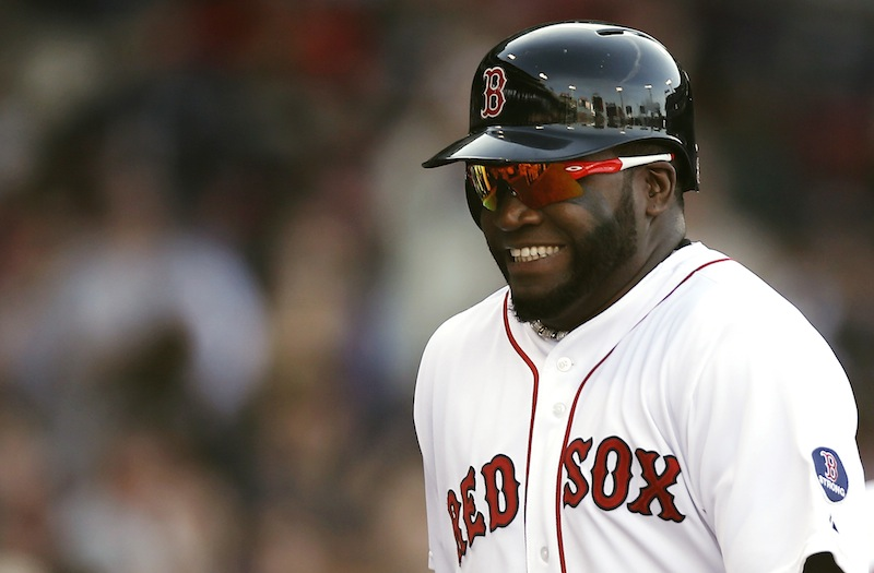 Boston Red Sox's David Ortiz smiles as he heads to the dugout after scoring on a double by Mike Napoli during the fourth inning at Fenway Park in Boston on Wednesday.