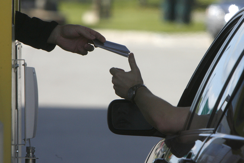 A driver hands his passport to a border agent at the U.S. border crossing in Highgate Springs, Vt.