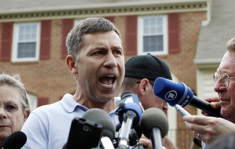"""In this April 19, 2013, file photo, Ruslan Tsarni, the uncle of the Boston Marathon bombing suspect, speaks with the media outside his home in Montgomery Village in Md. In the years before the Boston Marathon bombings, Tamerlan Tsarnaev fell under the influence of a new friend, a Muslim convert who steered the religiously apathetic young man toward a strict strain of Islam, family members said. """"Somehow, he just took his brain,"""" said Tsarni, who recalled conversations with Tamerlan's worried father about the friend of Tamerlan's known only to the family as Misha. (AP Photo/Jose Luis Magana, File)"""