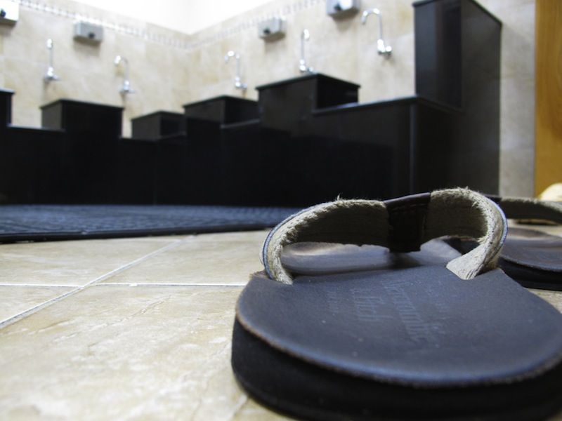 """A pair of sandals sits on the floor in the washroom at the Islamic Society of Boston mosque in Cambridge, Mass., on Friday, April 19, 2013. A mosque official confirmed that the two suspects in the Boston Marathon bombings, who lived a short distance away, worshipped there occasionally. Tamerlan Tsarnaev ranted at a neighbor about Islam and the United States. His younger brother, Dzhokhar, relished debating people on religion, """"then crushing their beliefs with facts."""" (AP Photo/Allen Breed)"""