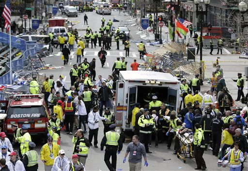 Medical workers aid injured people at the finish line of the 2013 Boston Marathon following an explosion in Boston on Monday, Two explosions shattered the euphoria of the Boston Marathon finish line, sending authorities out on the course to carry off the injured while the stragglers were rerouted away from the smoking site of the blasts.