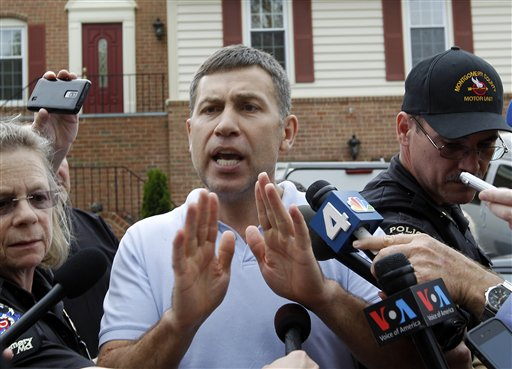 Ruslan Tsarni, uncle of the Boston Marathon bombing suspect, speaks with the media outside his home in Montgomery Village, Md., on Friday.