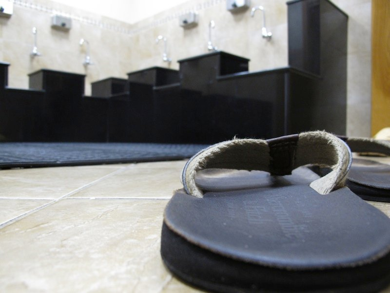 "A pair of sandals sits on the floor in the washroom at the Islamic Society of Boston mosque in Cambridge, Mass., on Friday, April 19, 2013. A mosque official confirmed that the two suspects in the Boston Marathon bombings, who lived a short distance away, worshipped there occasionally. Tamerlan Tsarnaev ranted at a neighbor about Islam and the United States. His younger brother, Dzhokhar, relished debating people on religion, ""then crushing their beliefs with facts."" (AP Photo/Allen Breed)"