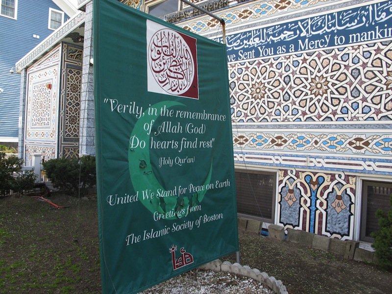 "A banner reading ""United We Stand For Peace on Earth"" stands outside the Islamic Society of Boston mosque in Cambridge, Mass., on Friday, April 19, 2013. A mosque official confirmed that the two suspects in the Boston Marathon bombings, who lived a short distance away, worshipped there occasionally. Tamerlan Tsarnaev ranted at a neighbor about Islam and the United States. His younger brother, Dzhokhar, relished debating people on religion, ""then crushing their beliefs with facts."" (AP Photo/Allen Breed)"