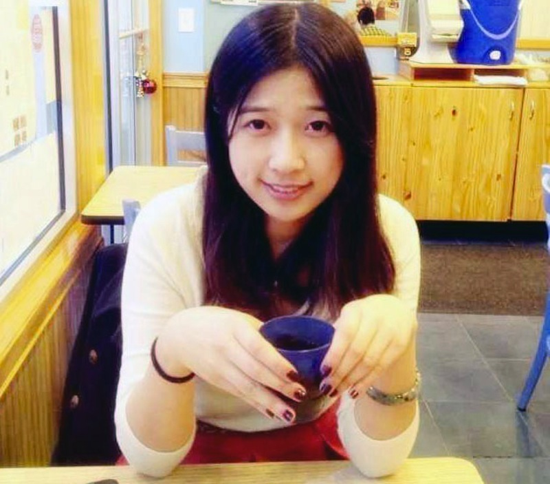 This undated photo provided by Meixu Lu shows Lingzi Lu in Boston. Boston University confirmed Wednesday, April 17, 2013, that Lingzi Lu, who was studying mathematics and statistics at the school and was due to receive her graduate degree in 2015, was among the people killed in the explosions at the finish line of the Boston Marathon Monday, April 15, 2013, in Boston. (AP Photo/Meixu Lu)