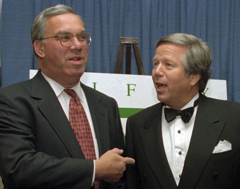 In this Nov. 8, 1995 file photo, Boston Mayor Thomas Menino, left, talks with England Patriots owner Robert Kraft, right, before a benefit dinner in Boston. Boston Mayor Thomas Menino fractured the smaller of the two bones in his lower leg on Friday, the latest in a series of health issues that have dogged the city's longest serving chief executive since the end of last year. (AP Photo/Steven Senne, File)