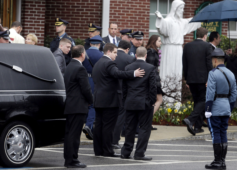Mourners depart St. Patrick's Church in Stoneham, Mass., following a private funeral Mass for Massachusetts Institute of Technology police officer Sean Collier on Tuesday. A memorial service will be held Wednesday.
