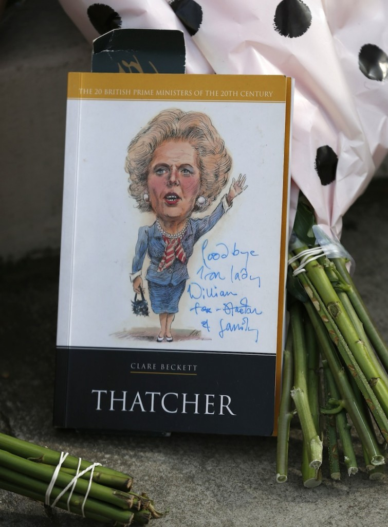 Floral tributes and memorabilia are seen outside the house of former British Prime Minister Margaret Thatcher who died from a stroke at the age of 87, London, Monday, April 8, 2013. (AP Photo/Sang Tan)