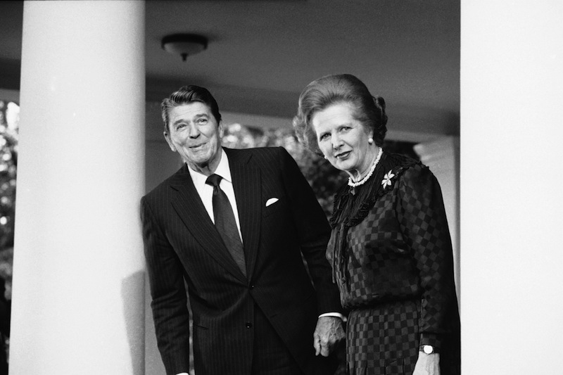 In this June 23, 1982 file photo, President Ronald Reagan and British Prime Minister Margaret Thatcher speak to reporters at the White House in Washington. Ex-spokesman Tim Bell says that Thatcher has died. She was 87. Bell said the woman known to friends and foes as