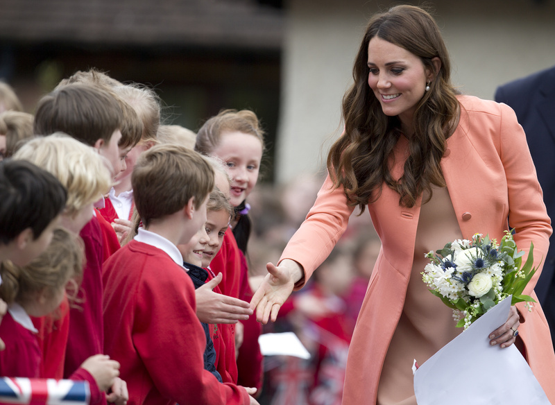 Kate, Duchess of Cambridge, shakes hands with schoolchildren after an official visit to Naomi House near Winchester, England, on Monday. Naomi House is a care home for children and young adults who have terminal conditions.
