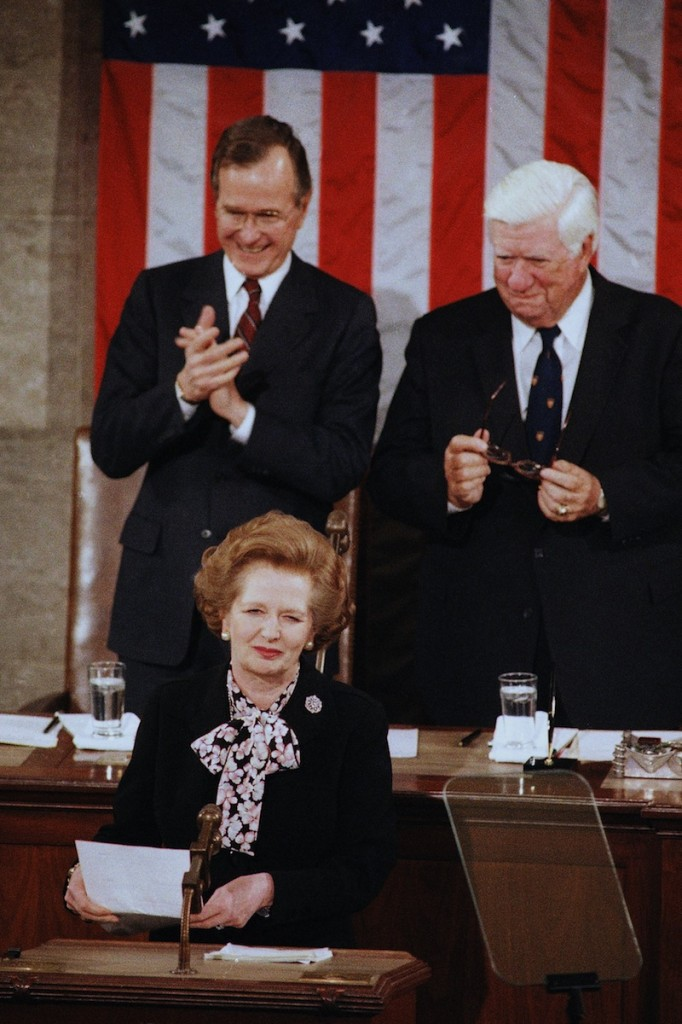 In a Feb. 20, 1985 file photo, British Prime Minister Margaret Thatcher is applauded by Vice President George Bush, left, as House Speaker Thomas P. O'Neill, Jr. looks on just before she addressed a joint meeting of the U.S. Congress, in Washington. Thatchers former spokesman, Tim Bell, said that the former British Prime Minister Margaret Thatcher had died Monday morning, April 8, 2013, of a stroke. She was 87. (AP Photo/Bob Daugherty, File) Authority Looking Away Standing Smiling Applauding