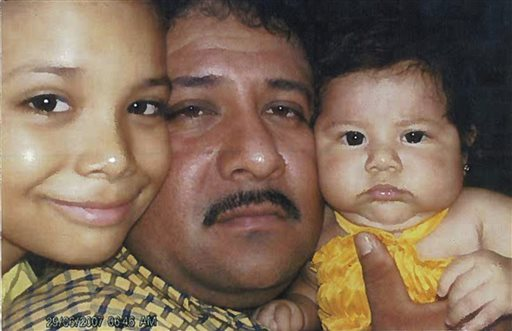 This photo dated 2007 from federal court documents shows Jose Gonzales-Zavala with two of his children. Prosecutors say Gonzales-Zavala was a member of the La Familia cartel, based in Mexico, and was dispatched to the Chicago area to oversee one of the cartel's lucrative trafficking cells. His defense team entered the photograph into evidence in arguing for leniency in his case. In 2011, he was sentenced to 40 years in prison by a federal judge in Chicago.