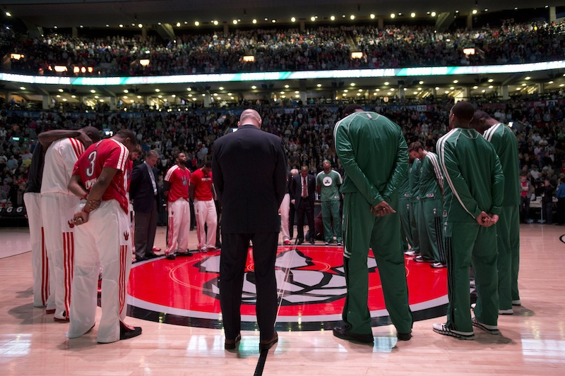 Toronto Raptors and Boston Celtics players observe a moment of silence for the victims of the Boston Marathon bombings before an NBA basketball game in Toronto, Wednesday April 17, 2013. (AP photo/The Canadian Press, Frank Gunn) basketball;Raptors;Association;athlete;athletes;athletic;athletics;Canada;Canadian;competative;compete;competing;competition;competitions;court;entertainment;event;game;league;National;NBA;player;players;pro;professional;sport;sporting;sports;Toronto