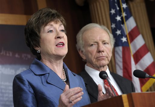 In this Dec. 31, 2012, photo, Sen. Susan Collins, R-Maine, speaks during a news conference on Capitol Hill as Sen. Joseph Lieberman, I-Conn., listens.