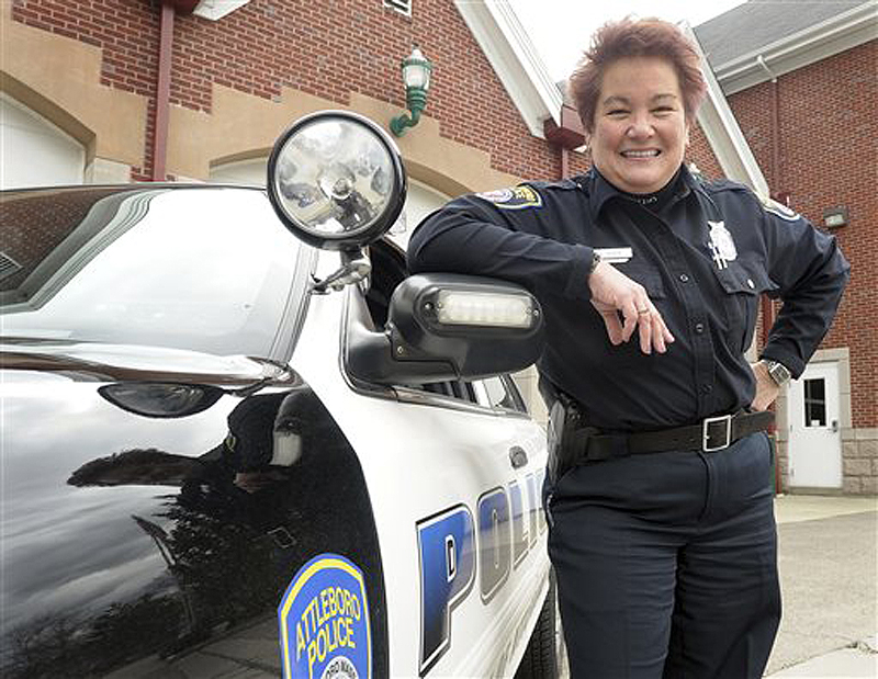 Police Officer Susan Boisse poses for a photo by her squad car in Attleboro, Mass. Boisse is credited with saving her 78-year-old mother's life by performing cardiopulmonary resuscitation on her in February.