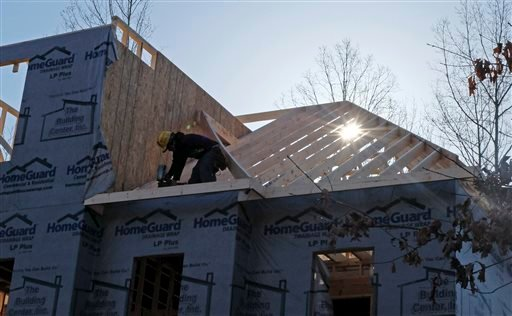A worker helps frame a new home under construction in Matthews, N.C. , recently. U.S. builders started work on the most homes and apartments in nearly five years in March, signaling momentum in the housing recovery.