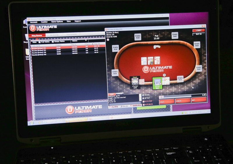 A sample poker game is played on the Ultimate Gaming website that launched Tuesday in Las Vegas.