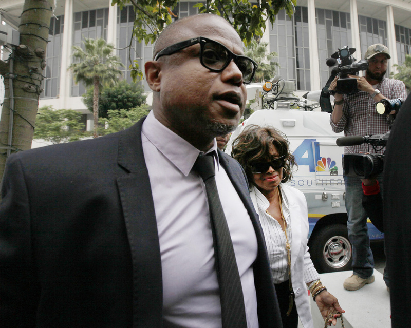 Randy Jackson and Rebbie Jackson, background right, brother and sister of late pop star Michael Jackson, arrive at a courthouse for Katherine Jackson's lawsuit against concert giant AEG Live in Los Angeles on Monday.