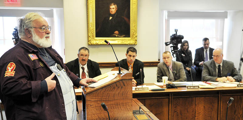 Donald Loncto, of Fletchers Landing Township, testifies against legislation to restrict the size of ammunition clips Monday at the State House in Augusta.