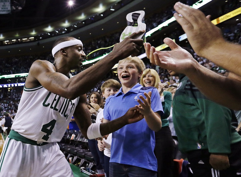 Boston Celtics guard Jason Terry gives his sneakers to fans as he leaves the court following their 97-90 win over the New York Knicks in overtime of Game 4 of a first-round NBA basketball playoff series in Boston, Sunday, April 28, 2013. (AP Photo/Elise Amendola) TD Garden