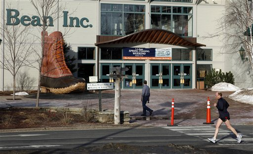 In this March 8, 2012 file photo, a jogger passes by the entrance to the L.L. Bean retail store in Freeport, Maine. L.L. Bean is donating $150,000 to help victims of the Boston Marathon bombing. (AP Photo/Robert F. Bukaty)