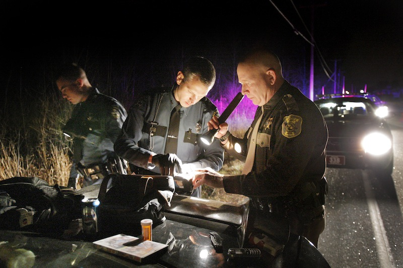 In this 2007 file photo, Maine State Police trooper Leonard Bolton, center, searches a vehicle with two other law-enforcement officers during a traffic stop in Gray. The FBI asked Bolton to help track the Boston Marathon bomb suspect because of his expertise in cellphone analysis.